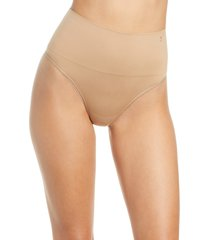 yummie ultralight seamless shaping thong, size large in almond at nordstrom