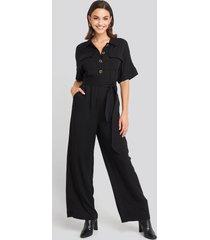 na-kd chest pocket buttoned jumpsuit - black