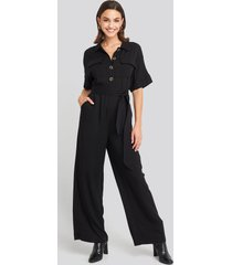 na-kd chest pocket buttoned jumpsuit - black