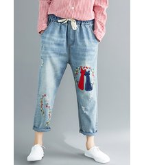 pantaloni in denim con tasche elastiche in vita ricamo