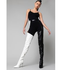 akira azalea wang take it higher belted stiletto chap boot in black white