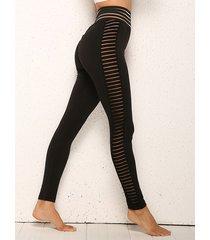 leggings de retazos de malla lateral negro