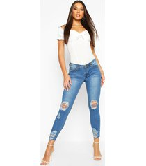 mid rise distressed knee and ankle skinny jeans, mid blue