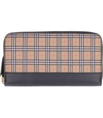 burberry leather zip around wallet with tartan inserts