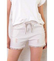 beige shorts damaged