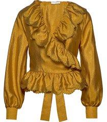 carly, 699 textured polyester blus långärmad guld stine goya