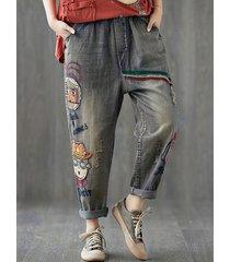 jeans larghi in denim con patchwork cartoon