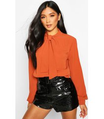 pussybow blouse, rust