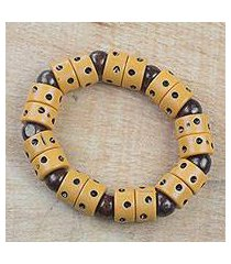 wood and recycled plastic beaded stretch bracelet, 'apple of meniwa' (ghana)