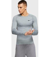 primera capa nike m np top ls tight gris - calce ajustado