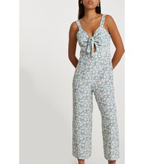 river island womens blue sleeveless floral front tie jumpsuit
