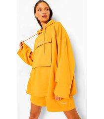 oversized hoodie met tekst en utility zakken, mustard