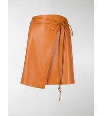 nanushka sekoya faux-leather wrap skirt