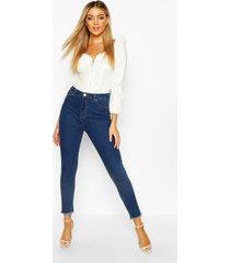 frayed hem skinny jeans, mid blue