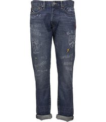 denim jeans with lettering and patches