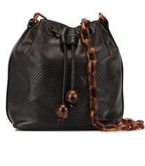 chanel pre-owned tortoiseshell chain drawstring shoulder bag - black