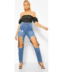 denim mom jeans met extreem gescheurde knieën, middenblauw