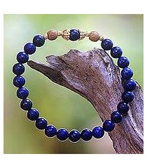 gold accented lapis lazuli beaded stretch bracelet, 'batuan tune' (indonesia)