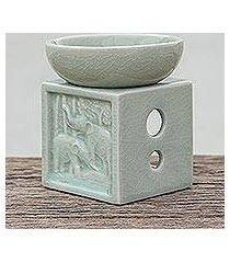 celadon ceramic oil warmer, 'elephant jungle' (thailand)