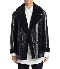reversible patent shearling jacket