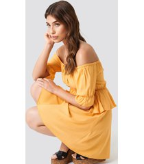 debiflue x na-kd off shoulder frill short dress - yellow