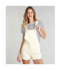 jardineira de sarja feminina com bolsos barra desfiada amarela