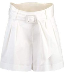 white pleated shorts with belt