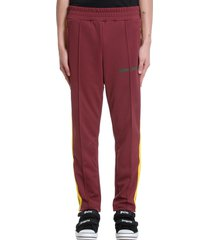 palm angels college pants in bordeaux polyester