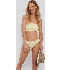 na-kd swimwear smocked flounce bikini panty - yellow
