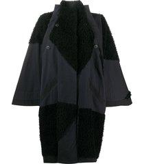 132 5. issey miyake oversized shearling panelled coat - black