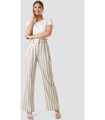 kae sutherland x na-kd tailored striped trousers - beige