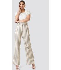 kae sutherland x na-kd tailored striped trousers - beige