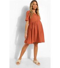 zwangerschap gesmokte jurk met knopen, terracotta