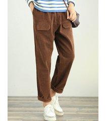 pantaloni con tasche laterali in tinta unita di velluto a coste