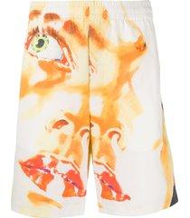 msgm portrait-print loose track shorts - orange