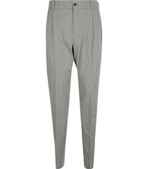 dolce & gabbana all-over houndstooth print trousers