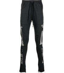 alchemist bandana-print ripped track-pants - black