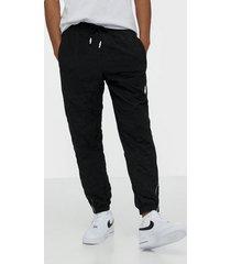 puma avenir woven pants byxor black