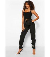tall slim fit broek met ceintuur en enkelstrikjes, zwart