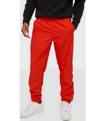 lacoste pantalon de survetement byxor red