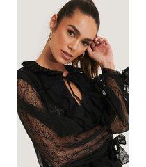 trendyol blus med spetsärm - black