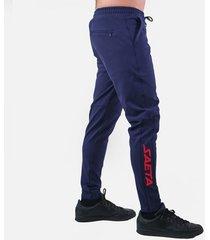 pantalon tipo jogger palmeira imparable- azul oscuro rojo saeta