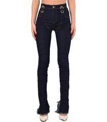 jeans skinny con dettagli decorativi sulla cintura