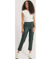 mango apple trousers - green