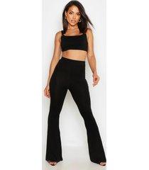 basic strakke broek met hoge taille en wijd uitlopende pijpen, zwart