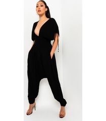 akira out on the town sleeveless deep v flowy jumpsuit