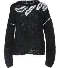 of handmade sweaters