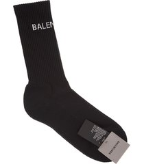 black man socks with white logo