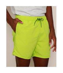 short masculino com cordão e bolsos verde neon
