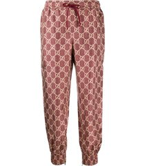 gucci gg supreme canvas track pants - red